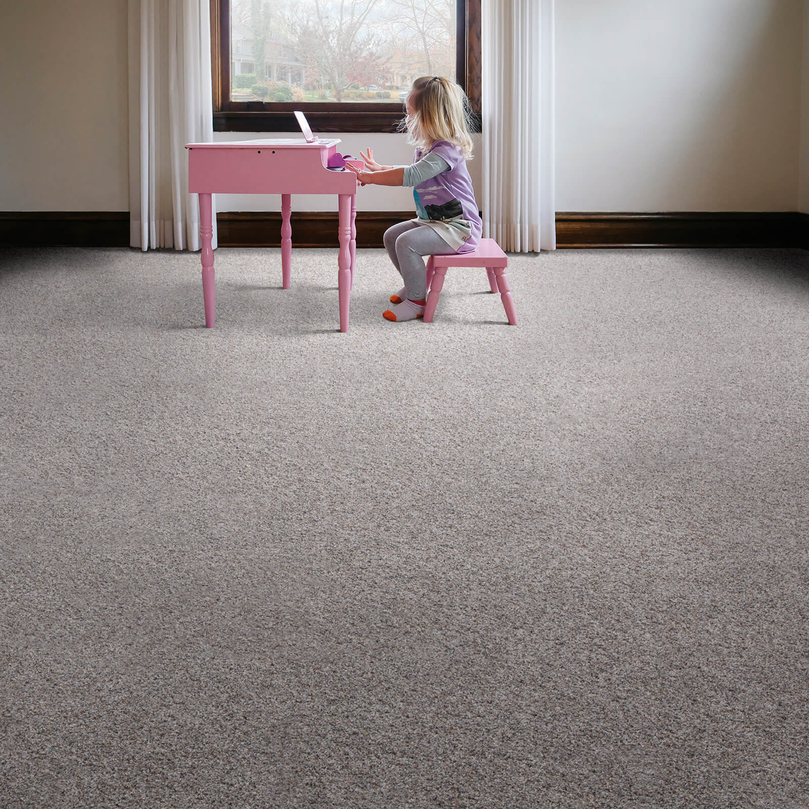 Girl with piano on Carpet flooring | Georgia Flooring