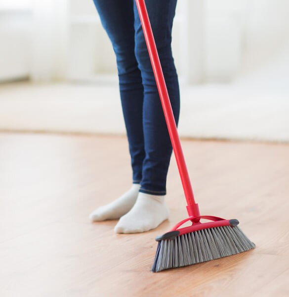 Sweeping laminate floor in Tallahassee, FL | Georgia Flooring